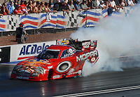 Apr 7, 2006; Las Vegas, NV, USA; NHRA Funny Car champion Gary Scelzi does a burnout in his Mopar Charger during qualifying for the Summitracing.com Nationals at Las Vegas Motor Speedway in Las Vegas, NV. Mandatory Credit: Mark J. Rebilas