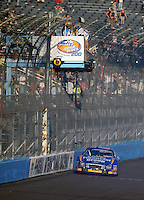 Nov. 8, 2008; Avondale, AZ, USA; NASCAR Nationwide Series driver Carl Edwards takes the checkered flag to win the Hefty Odor Block 200 at Phoenix International Raceway. Mandatory Credit: Mark J. Rebilas-
