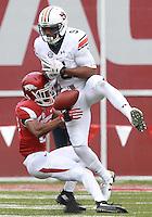 Arkansas Democrat-Gazette/BENJAMIN KRAIN --10/24/2015--<br /> Arkansas defensive back Jared Collins (29) breaks up a pass to Auburn WR Ricardo Louis in the 3rd quarter.