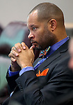 Nevada Senate Minority Leader Aaron Ford, D-Las Vegas, works in committee at the Legislative Building in Carson City, Nev., on Wednesday, Feb. 18, 2015. <br /> Photo by Cathleen Allison