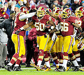 Washington Redskins linebacker Rob Jackson (50) celebrates with teammates Stephen Bowen (72), left, and Perry Riley (56), right, following his late fourth quarter interception against the Dallas Cowboys at FedEx Field in Landover, Maryland on Sunday, December 30, 2012.  The Redskins won the game 28 - 18 to capture the NFC East title..Credit: Ron Sachs / CNPDallas Cowboys against the Washington Redskins at FedEx Field in Landover, Maryland on Sunday, December 30, 2012.  The Redskins won the game 28 - 18 to capture the NFC East title..Credit: Ron Sachs / CNP.(RESTRICTION: NO New York or New Jersey Newspapers or newspapers within a 75 mile radius of New York City)
