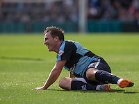 Garry Thompson of Wycombe smiles despite being floored during the Sky Bet League 2 match between Wycombe Wanderers and Hartlepool United at Adams Park, High Wycombe, England on 5 September 2015. Photo by Andy Rowland.