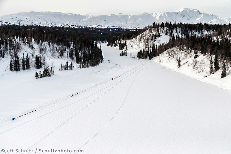Teams run on Red Lake just after leaving the Finger Lake checkpoint on their way to the Rainy Pass checkpoint during Iditarod 2016.  Alaska.  March 07, 2016.  <br /> <br /> Photo by Jeff Schultz (C) 2016 ALL RIGHTS RESERVED