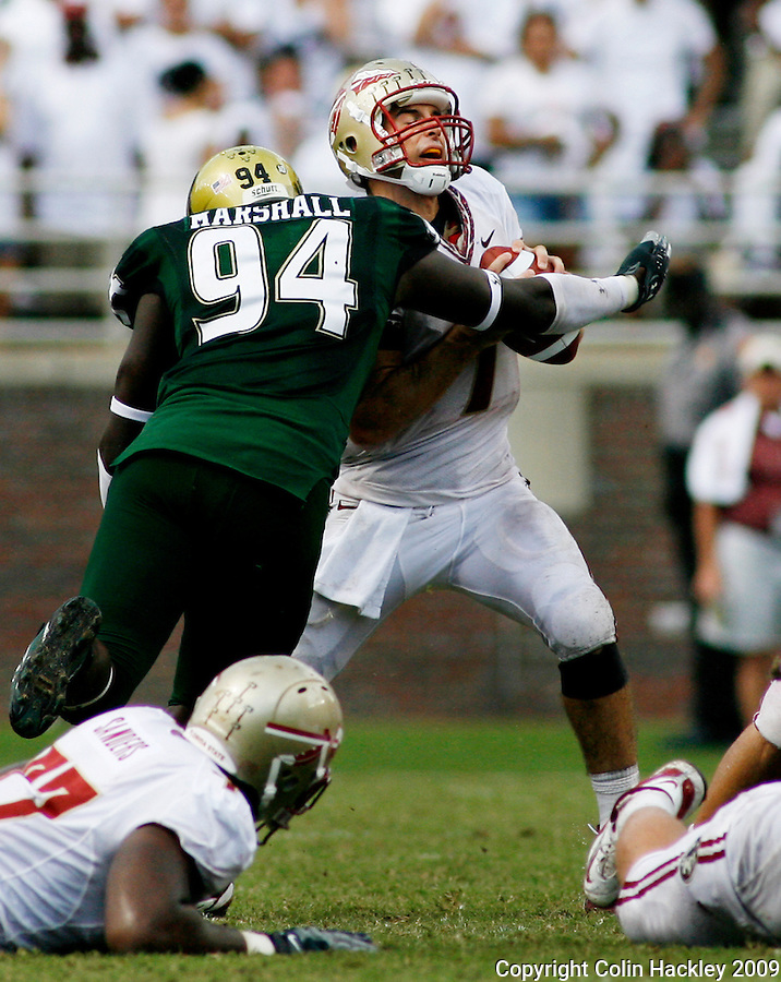 TALLAHASSEE, FL 9/26/09-FSU-USF FB09 CH19-Florida State's Christian Ponder is sacked by South Florida's Craig Marshall during second half action Saturday at Doak Campbell Stadium in Tallahassee. The Bulls beat the Seminoles 17-7...COLIN HACKLEY PHOTO
