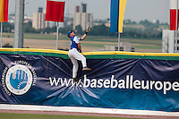 30 july 2010: Romain Scott Martinez of France fails to catch the ball on a home run during Italy 9-2 win over France, in day 6 of the 2010 European Championship Seniors, at TV Cannstatt ballpark, in Stuttgart, Germany.