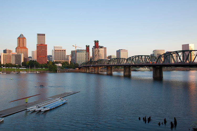 The view of the downtown Portland, Oregon, Tom McCall Waterfront Park and the Hawthorne Bridge from the Eastbank Esplanade at sunrise.