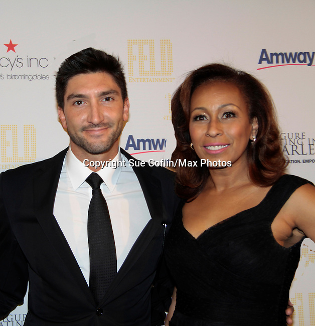 Olympic Figure Skater Champsion Evan Lysacek & As The World Turns' Tamara Tunie - 10th Annual Gala celebrating Figure Skating in Harlem's 18th year of operations at The Stars 2015 Benefit on April 13, 2015 in New York City, New York honoring Olympic Champion Evan Lysacek. (Photo by Sue Coflin/Max Photos)