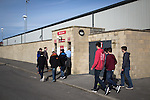 Home fans entering the turnstiles at the Globe Arena before Morecambe hosted Plymouth Argyle in a League 2 fixture. The stadium was opened in 2010 and replaced Morecambe's traditional home of Christie Park which had been their home since 1921, the year after their foundation. Plymouth won this fixture by 2-0 watched by 2,081 spectators, in a game delayed by 30 minutes due to traffic congestion affecting travelling Argyle fans.