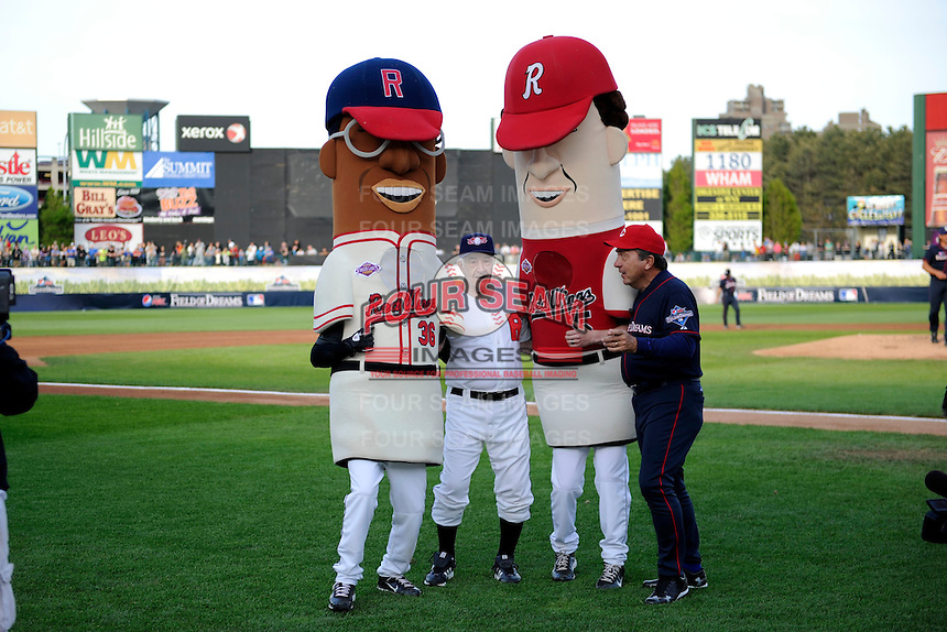 Former Baltimore Orioles and Rochester Red Wings manager Joe Altobelli and Hall of Fame catcher Johnny Bench distract the mascots of Luke Easter and Cal Ripken Jr. during the legends race on field promotion to allow the Joe Altobelli mascot to win during the MLB Pepsi Max Field of Dreams game on May 18, 2013 at Frontier Field in Rochester, New York.  (Mike Janes/Four Seam Images)