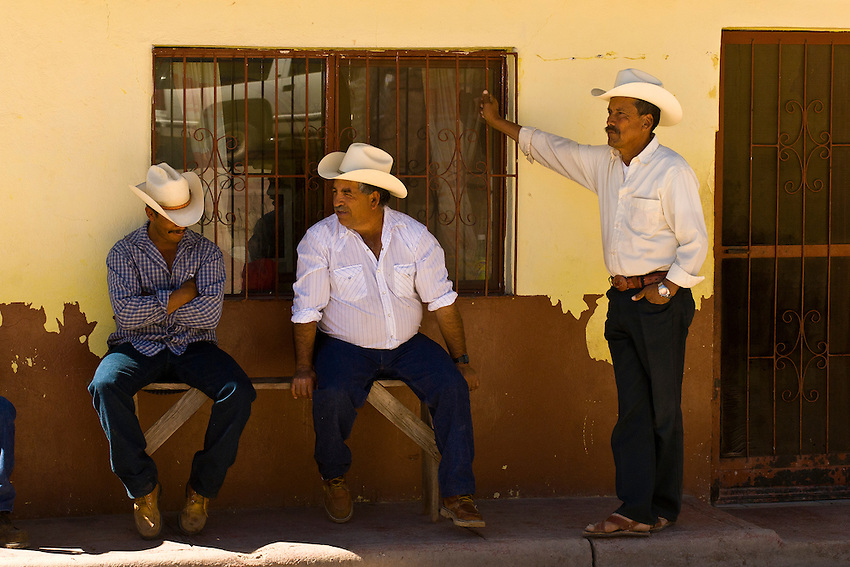 Local men in the town square, Cerocahui, Urique Canyon (one of the six canyons that comprise the Copper Canyon), Mexico