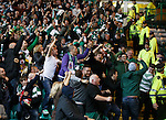 Celtic fans rejoice to the Ajax support after the penalty goes in