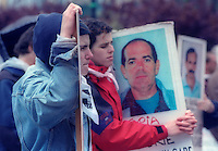 Families of Basque prisoners hold plackards with prisoners pictures during a protest in Donostia / San Sebastian.Senideak, 1999- 4- 18.Photo: Ander Gillenea