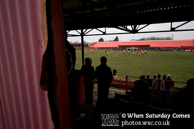 Workington AFC 0 Boston United 1, 24/02/2008. Borough Park, Blue Square North. Fans on the Popular Side watching the action during the Blue Square North fixture between hosts Workington AFC (red) and Boston United at Borough Park. The visitors won with a solitary sixth-minute goal by Jon Rowan in front of 388 spectators. Both Workington AFC and Boston United were members of the Football League, the Cumbrians losing League status in 1977 while the Lincolnshire club were relegated in 2007 and demoted two divisions for financial irregularities. Photo by Colin McPherson.