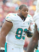 Miami Dolphins defensive tackle Ndamukong Suh (93) speaks to a teammate during the two minute warning in the first half against the Washington Redskins at FedEx Field in Landover, Maryland on September 13, 2015.<br /> Credit: Ron Sachs / CNP