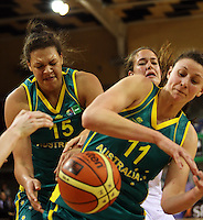 Opals' Elizabeth Cambage and Elyse Penaluna compete for the ball as Ferns centre Kim Barnes (back) looks on during the International women's basketball match between NZ Tall Ferns and Australian Opals at Te Rauparaha Stadium, Porirua, Wellington, New Zealand on Monday 31 August 2009. Photo: Dave Lintott / lintottphoto.co.nz