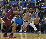 Nevada guard Jazz Johnson (22) drives against Little Rock in the first half of an NCAA college basketball game in Reno, Nev., Friday, Nov. 16, 2018. (AP Photo/Tom R. Smedes)