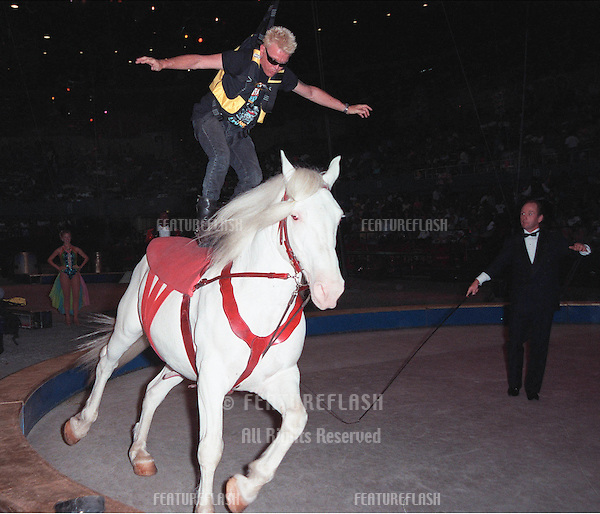 21JUL99: Rock star BILLY IDOL tries his hand at trick horseback riding at the Los Angeles opening night of Ringling Bros and Barnum & Bailey Circus. The evening was to benefit the Cystic Fibrosis Foundation.                           © Paul Smith / Featureflash