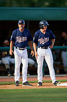 Elizabethton Twins left fielder Tyler Webb (30) stands on third base as batting coach Jeff Reed (1) looks on during a game against the Bristol Pirates on July 28, 2018 at Joe O'Brien Field in Elizabethton, Tennessee.  Elizabethton defeated Bristol 5-0.  (Mike Janes/Four Seam Images)