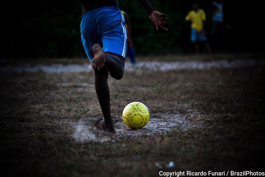 Penalty shoot-out, kick from the penalty mark, in Brazil black boys with remarkable talent for football usually have the nickname of Pelé. Rural area of Maranhao State, Northeast Brazil.