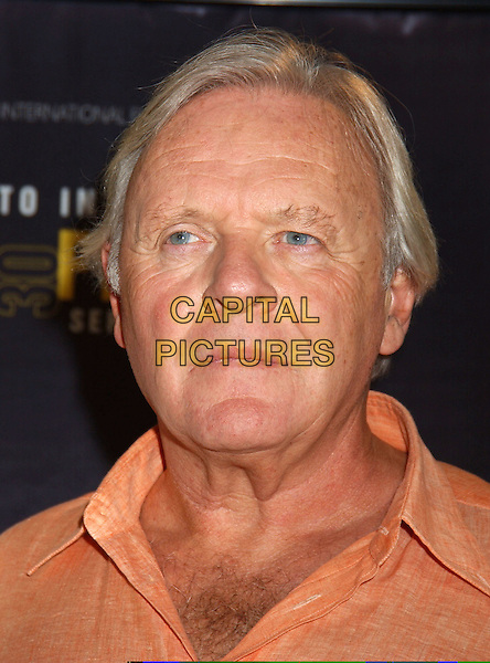 "SIR ANTHONY HOPKINS.At the ""Proof"" Press conference held at Sutton Place,.Toronto Film Festival,.Toronto, 12th September 2005.portrait headshot orange shirt.Ref: FARR.www.capitalpictures.com.sales@capitalpictures.com.© Capital Pictures."