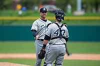 Columbus Clippers relief pitcher Jon Edwards (50) celebrates a victory with Tim Federowicz (40) after an International League game against the Indianapolis Indians on April 30, 2019 at Victory Field in Indianapolis, Indiana. Columbus defeated Indianapolis 7-6. (Zachary Lucy/Four Seam Images)