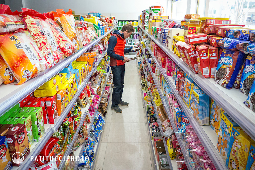 David Göttler shopping in a Tibetan grocery store in preparation for a climbing expedition to Shishapangma
