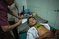 Child being examined in one of the local clinics.