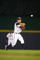 Mississippi Braves shortstop Eric Garcia (4) throws to first during a game against the Pensacola Blue Wahoos on May 27, 2015 at Trustmark Park in Pearl, Mississippi.  Pensacola defeated Mississippi 7-5 in fourteen innings.  (Mike Janes/Four Seam Images)