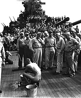 Japanese prisoners of war are bathed, clipped, &quot;deloused,&quot; and issued GI clothing as soon as they are taken aboard the USS NEW JERSEY.  Prisoner bathing.  December 1944.  Lt. Comdr. Charles Fenno Jacobs.  (Navy)<br /> Exact Date Shot Unknown<br /> NARA FILE #:  080-G-469956<br /> WAR &amp; CONFLICT BOOK #:  1305