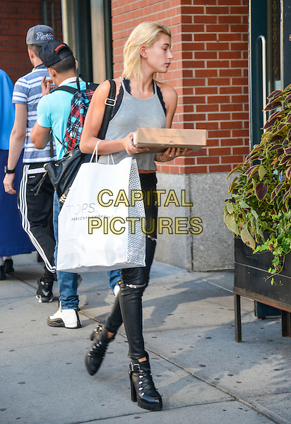 NEW YORK, NY - AUGUST 29: Hailey Baldwin returns to apartment with donuts in Soho in New York, New York on August 29, 2014. <br /> CAP/MPI/MPI67<br /> &copy;MPI67/MPI/Capital Pictures