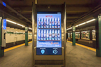 """An advertisement for the Netflix hit show """"Orange is the New Black"""" on a digital display in a subway station in New York on Tuesday, June 23, 2015. The streaming service, formerly a dvd mailing service, Netflix recently announced a seven for one stock split on the heels of its stock almost doubling this year. (© Richard B. Levine)"""
