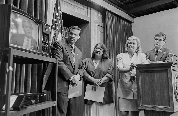 Rep. Bob Filner, D-Calif., Rep. Lynn N. Rivers, D-Mich., Rep. Carolyn Maloney, D-N.Y., District Attorney Pat Meehan, watching a Newt Gingrich and Bill Clinton clip during a press conference on lobbying the Code of Federal Regulations, on July 17, 1995. (Photo by Laura Patterson/CQ Roll Call via Getty Images)