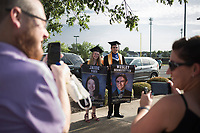 Graduates Jaide Yoes (from center left) and Wesley Gernstetter pose for pictures, Friday, July 17, 2020 during a graduation ceremony at Bentonville High School in Bentonville. Check out nwaonline.com/200718Daily/ for today's photo gallery. <br /> (NWA Democrat-Gazette/Charlie Kaijo)