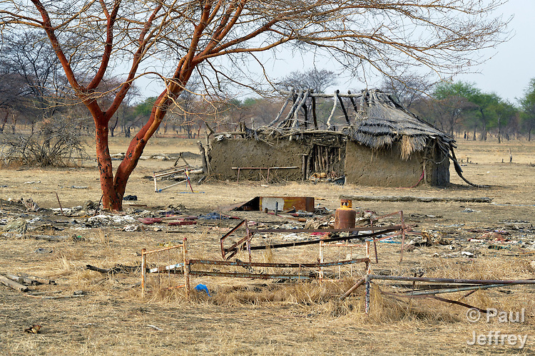 The remains of a partially-destroyed house in Mijak, a village in the contested Abyei region from which residents fled in 2011 after an attack by soldiers and militias from the northern Republic of Sudan. Although the 2005 Comprehensive Peace Agreement called for residents of Abyei--which sits on the border between Sudan and South Sudan--to hold a referendum on whether they wanted to align with the north or the newly independent South Sudan, the government in Khartoum and northern-backed Misseriya nomads, excluded from voting as they only live part of the year in Abyei, blocked the vote and attacked the majority Dinka Ngok population. The African Union has proposed a new peace plan, including a referendum to be held in October 2013, but it has been rejected by the Misseriya and Khartoum. The Catholic parish of Abyei, with support from Caritas South Sudan and other international church partners, has maintained its pastoral presence among the displaced and assisted them with food, shelter, and other relief supplies.