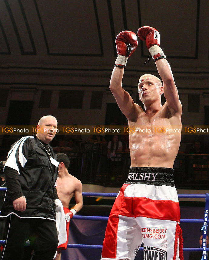 Michael Walsh (Cromer, red/white shorts) defeats Fouad El Bahji (France, red shorts) in a Super-Flyweight contest at York Hall, Bethnal Green, promoted by Frank Warren, Sports Network - 14/06/08 - MANDATORY CREDIT: Gavin Ellis/TGSPHOTO. Self-Billing applies where appropriate. NO UNPAID USE. Tel: 0845 094 6026