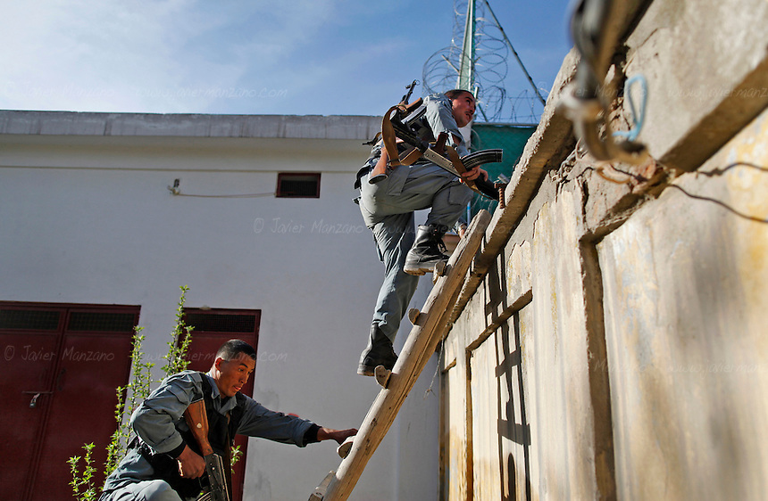 Afghan security forces climb a ladder to gain on their way to support their comrades as they try to neutralize a group of suspected insurgents that took control of a building in Kabul. Heavy weapons fire and rocket-propelled explosions could be heard across the Afghan capital city of Kabul on April 15th, 2012. ..Several targets were hit by alleged insurgents in and around the Shahre Naw and in Shash Darak areas of Kabul, where at least one rocket/mortar impacted the vicinity of the International Security Assistance Forces Headquarters. Heavy gunfire and explosions detonated around the Kabul Star Hotel and Azizi Bank (close to ISAF HQ). The gunfire began when an unconfirmed number of insurgents drove an SUV through the doors of a 5-story building (currently under construction) and used it as a base to launch attacks on ANSF and Norwegian Military Forces (who came to assist the Afghan Security forces). Casualties include one ANSF dead, four ANSF injured and an IMF wounded. ..It has further been confirmed that besides the attack at the Parliament complex earlier in the afternoon, ANSF interdicted a second tier attack in the vicinity of the 2nd Vice-President's residence and arrested two AOG equipped with BBIEDs and another infantry operative in the location..According to an ISAF press release, the attacks, which were concentrated in three clusters around the city, were  labeled  by the Taliban as the start of the so-called ?Spring Offensive? and were largely ineffective. .The attacks began just before 2:00 p.m. and consisted primarily of RPG and small arms fire.  Afghan Crisis Response Units along with Afghan police  and Army forces deployed to repel the attacks that resulted in light casualties while killing or capturing many of  the  suicide attackers in a matter of hours...National Directorate of Security announced that they had captured two suicide bombers alive before they were able to reach their intended targets. ..ISAF quick reaction forces were prepared to res