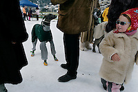 Even dogs are well-dressed in St. Moritz where pet greyhounds participate in the annual grayhound race on a track built on the ice.