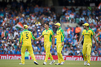 Aaron Finch (Australia) and GlennMaxwell congratulate Marcus Stones (Australia) on the dismissal of MS Dhoni (India) during India vs Australia, ICC World Cup Cricket at The Oval on 9th June 2019