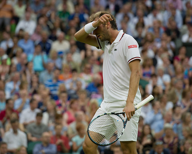 Julien Benneteau FRA (29)  in action today during his Gentlemen's Singles Third Round match against Roger Federer SUI (3)..Tennis - Wimbledon Lawn Tennis Championships - Day 5 - Friday 29th June 2012 -  All England Lawn Tennis Club - Wimbledon - London - England...