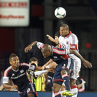 New England Revolution defender Jose Goncalves (23) and D.C. United defender Ethan White (15) battle for head ball. New England Revolution midfielder Juan Agudelo (10). In a Major League Soccer (MLS) match, the New England Revolution (blue) tied D.C. United (white), 0-0, at Gillette Stadium on June 8, 2013.