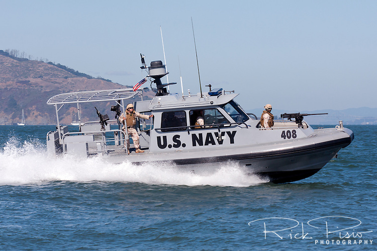 U.S. Navy Security forces patrol the San Francisco waterfront in a 34 foot Sea Ark Navy security boat.
