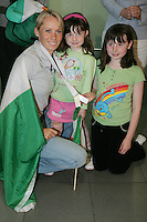 2/8/2010. Derval O'Rourke arrives back into Dublin Aiorport pictrured with fans Grainne 5 and Sarah 9 Hanley from Skryne Co Meath. European silver-medallist Derval O'Rourke has arrived home from Barcelona.O'Rourke finished second in the 100m hurdles on Saturday night to win her second European Athletics Championship silver medal. She was presented with her medal at the Olympic Stadium in Barcelona yesterday evening. Picture James Horan/Collins Photos