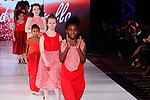 Models walk runway in outfits at the close of The Red Umbrella collection fashion show, at The Society Fashion Week on September 9, 2018 at The Roosevelt Hotel in New York City, during New York Fashion Week Spring Summer 2019.