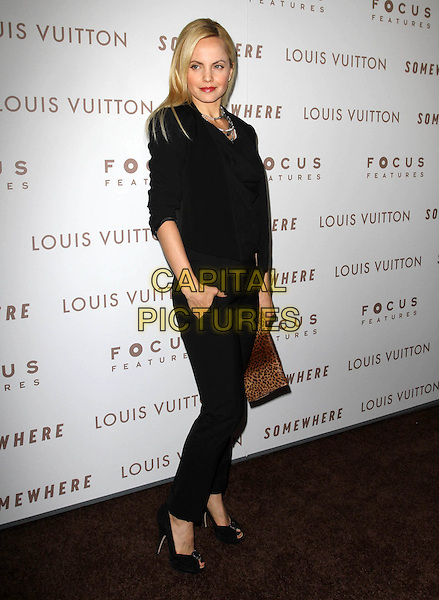 "MENA SUVARI.Premiere of ""Somewhere"" held At The Arclight Theatres, Hollywood, CA, USA..December 7th, 2010.full length black top jeans denim clutch bag brown leopard print hand in pocket.CAP/ADM/KB.©Kevan Brooks/AdMedia/Capital Pictures."