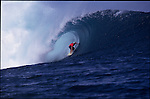 Teahupoo, Tahiti. May 2000. A surfer  gets tubed during the GOTCHA PRO 2000 at Teahupoo.