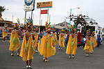 COSTUMED YOUNG WOMEN IN CARNIVAL PARADE