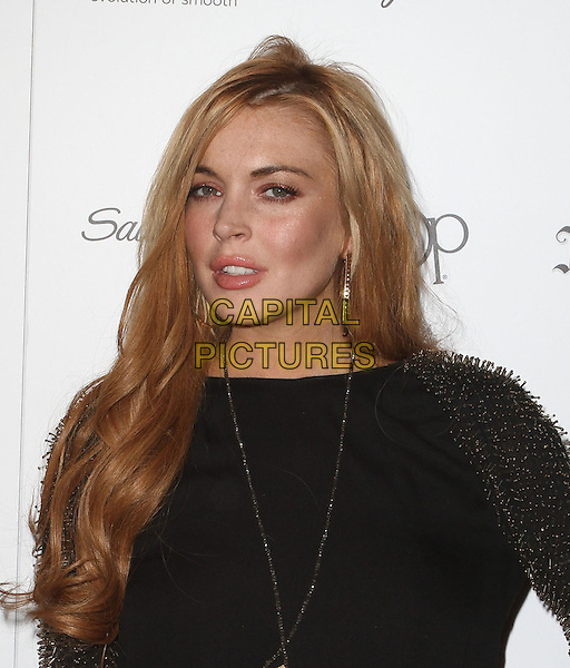 "Lindsay Lohan.Star Magazine's ""All Hollywood"" Event With Performance By Karmin Held at AV Nightclub, Hollywood, California, USA..April 24th, 2012.headshot portrait black gold beads beaded sleeves spiked  .CAP/ADM/KB.©Kevan Brooks/AdMedia/Capital Pictures."