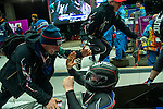 KRASNAYA POLYANA, RUSSIA  - JANUARY 17:<br /> USA bobsled Head Coach Brian Shimer, left, congratulates pilot Steven Holcomb, as Christopher Fogt goes to celebrate with brakeman Steven Langton, not pictured, after competing in the men's two-man bobsled at Sanki Sliding Center during the 2014 Sochi Olympics Monday February 17, 2014. USA-1 with Steven Holcomb, of Park City, Utah, and Steve Langton, of Melrose, Mass., won the bronze medal with a time of 3:46.27.<br /> (Photo by Chris Detrick/The Salt Lake Tribune)