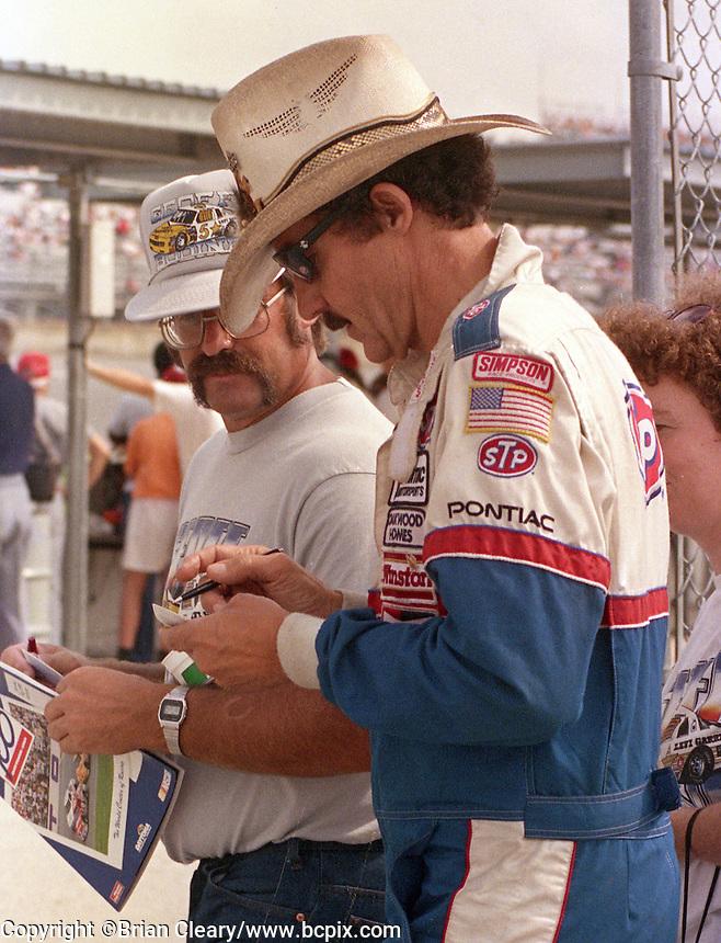 Richard Petty signs autograph fan Pepsi 400 at Daytona International Speedway in Daytona beach, FL on July 1, 1989. (Photo by Brian Cleary/www.bcpix.com)