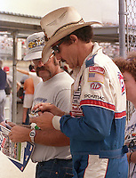 Richard Petty signs autograph fan Pepsi 400 at Daytona International Speedway in Daytona beach, FL on July 1, 1989. (Photo by Brian Cleary/www.bcpix.com)